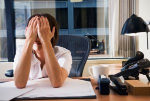 getty_rm_photo_of_tired_woman_at_office[1]