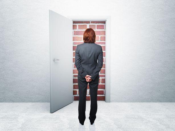12381489 - standing woman and closed door