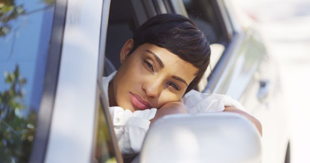 33804064 - black woman resting head out car window